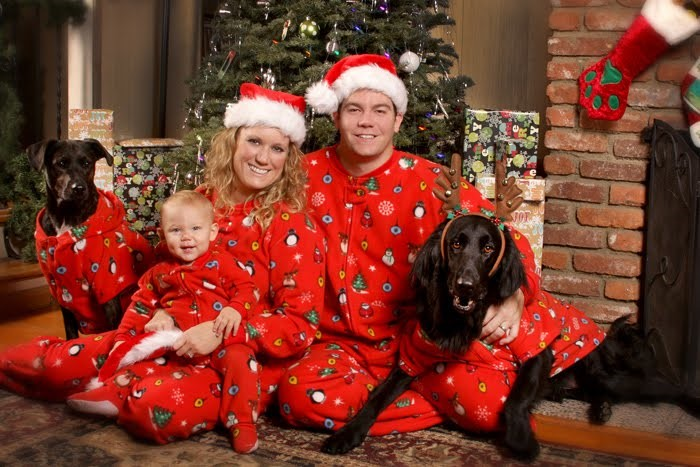 Traditional – We dress alike down to the pets and sit in front of the Christmas tree. It's cheesy but brings a sort of Brady Bunch feel.